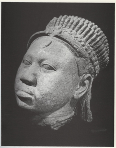 Head of a queen (broken off from a figure), wearing a crown of five tiers. From Ita Yemoo. 12-15th century. Terracotta. Museum of Ife Antiquities. [See Source 2]