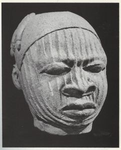 Photo 2: Head of man with raised weals. From Inwinrin Grove. 12th-15th century. Terracotta. Museum of Ife Antiquities. [See Source 2]