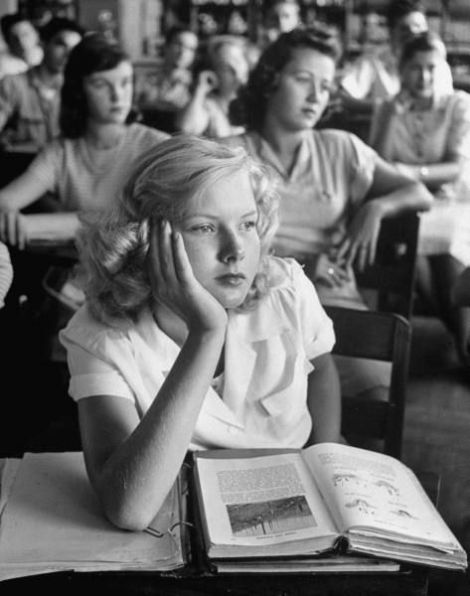 A girl daydreaming during class, Florida, March 1947. Photo by Allan Grant.