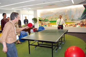 Steve Vinter, head of Google Boston office, and Deval Patrick, governor of Massachusetts, play ping pong at grand opening of Google Boston office.